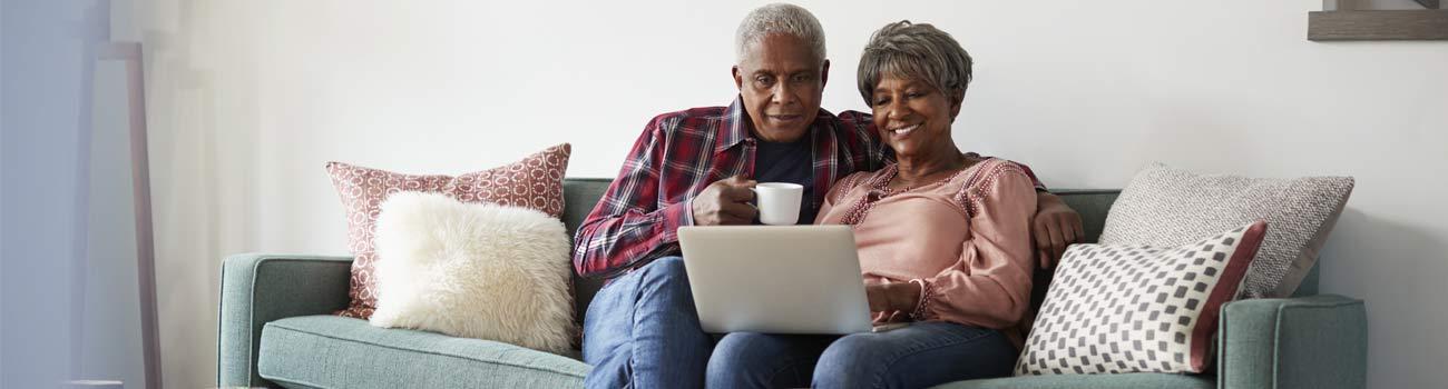 couple-viewing-laptop-1300x350