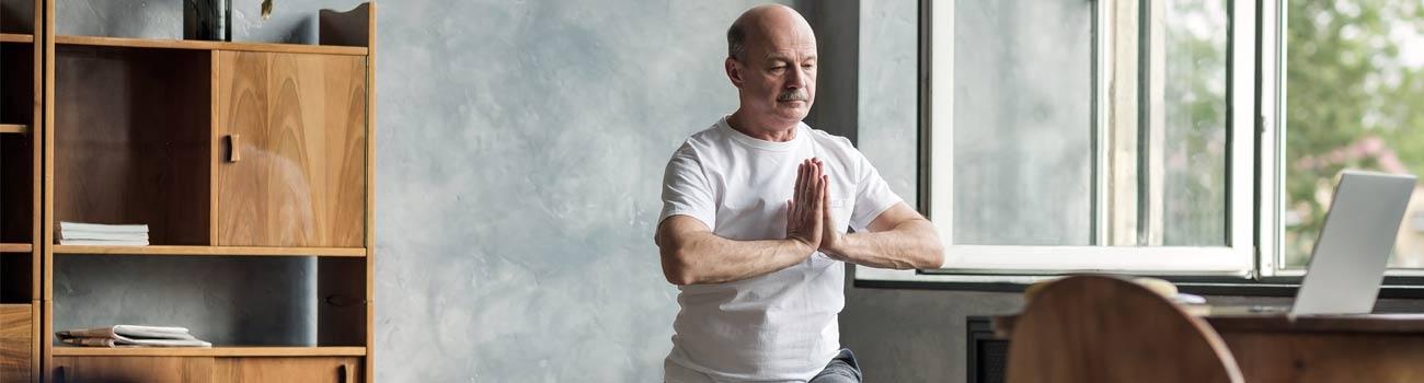 man-doing-yoga-1300x350