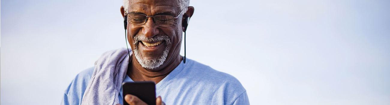 man-looking-at-phone-1300x350