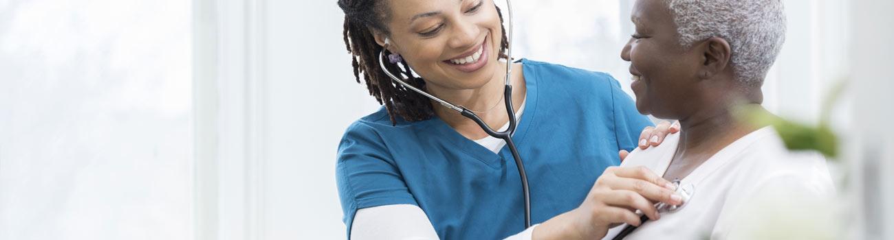 nurse-with-patient-1300x350